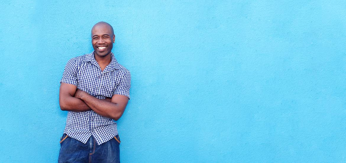 handsome-black-man-smiling-with-arms-crossed-PBDR7CZ1.jpg